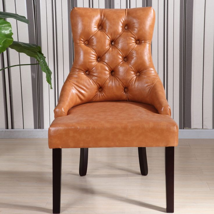 Stylish Luxury Leather Dining Chairs These Parson Dining Chairs Highlight A Button Tufted And Copper